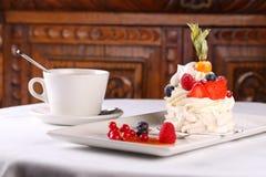 Delicious meringue cake with cream Stock Image