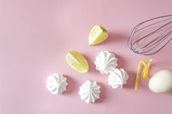 Delicious meringues with lemon flavor. Ingredients for cooking tasty meringues stock images