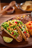 Delicious mexican food restaurant style tacos with rice beans and tortilla chips Stock Image