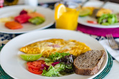 Delicious mexican style breakfast with omelette, ham and bread Stock Photo