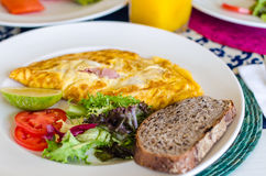 Delicious mexican style breakfast with omlette, ham and bread Stock Image