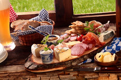 Delicious midday meal of a meat and cheese platter Royalty Free Stock Image