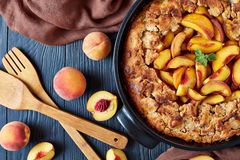 Delicious and mildly sweet Peach cobbler. In a black baking dish, view from above, flat lay royalty free stock image