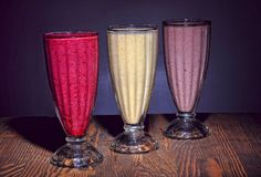 Multicolored berry smoothies. royalty free stock images