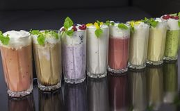 Delicious milkshakes with whiped cream and berries Royalty Free Stock Photo