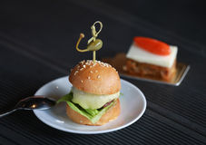 Delicious mini burger canapes. On a white plate Stock Photos