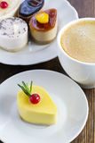 Delicious mini cakes and a cup of coffee Royalty Free Stock Photography