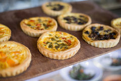 Delicious mini quiches on tray Stock Photography