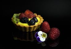 delicious mini tart with custard with raspberries and blueberries stock photography