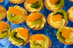 Delicious mini tart with kiwi and oranges Royalty Free Stock Image