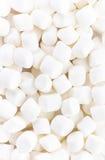 Delicious mini White Fluffy Round Marshmallows on white backgr Royalty Free Stock Image