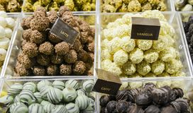 Delicious mix of different types of Italian chocolate sweets ranging from coffee to milk to vanilla on display at market. In Milan, Lombardy, Italy Stock Image