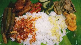 Delicious mix rice. Delicious and aromatic mix rice with various side dish as fish asam pedas with bendi, crispy fry shrimps, bitter gourd with sambal belacan royalty free stock photos