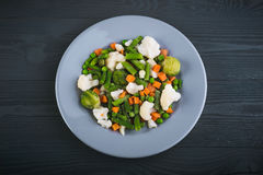 Delicious mix of vegetables on the plate. View from above. stock images