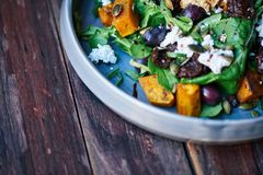 Delicious mixed salad sitting on a rustic wooden table Stock Photo