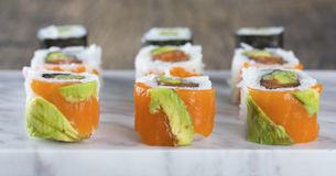 Delicious mixed sushi arranged on white marble surface Stock Photography
