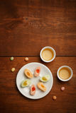 Delicious mochi rice cakes on white plate, porcelain cups with g Royalty Free Stock Photos