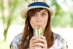 Delicious mohito drink. Young woman drinking mojito drink Royalty Free Stock Images