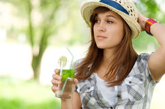 Delicious mohito drink. Young woman drinking mojito drink Stock Photos
