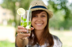 Delicious mohito drink. Young woman drinking mojito drink Royalty Free Stock Image