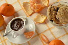 Delicious morning coffee with cookies and tangerines Royalty Free Stock Images