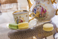 Delicious Morning macarons with tea royalty free stock images