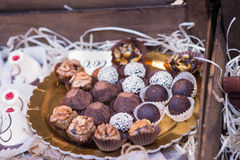 Delicious mouthwatering chocolates. On the counter outdoors Stock Photos
