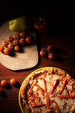 Delicious mozzarella cheese pizza with pepper slices. Delicious pizza with mozzarella cheese and pepper on wooden texture royalty free stock photography