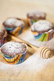 Delicious Muffins. Over wooden board selective focus Stock Photography