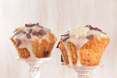 Delicious muffins with chocolate decoration. Royalty Free Stock Photos
