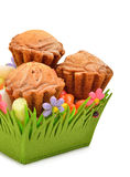 Delicious muffins, colorful caramels in the green basket Stock Image