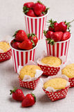 Delicious muffins in the form of polka dots, strawberries in a s royalty free stock photo