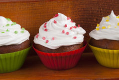 Delicious muffins with white cream Stock Photos
