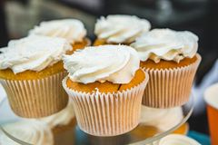 Delicious muffins with white cream stock photography