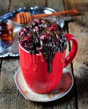 Delicious Mug Cake, chocolate cherry cake cooked in a cup in the microwave Royalty Free Stock Photos