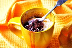 Delicious Mug Cake, chocolate cherry cake cooked in a cup in the microwave Stock Photos