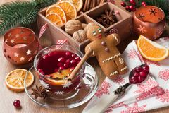 Delicious mulled wine winter aromatic spice hot alcohol drink. Mulled wine winter hot drink in glass mug with cranberry, cinnamon, dried orange slices, anise royalty free stock photography