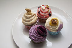 Delicious multicolor cupcakes ounder contrast lightming Stock Photo