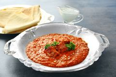 Delicious Murgh Makhani in metalic plate. On table Stock Image