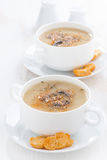 Delicious mushroom cream soup with croutons in bowls Royalty Free Stock Image
