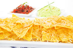 Delicious nachos baked with cheese. Royalty Free Stock Photography