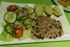 Delicious Nicaraguan food. Nicaragua food, gallopinto with salad royalty free stock photos