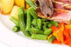 Delicious nicoise salad with beans and anchovies. Royalty Free Stock Image