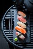Delicious Nigiri sushi with octopus, prawn and salmon Stock Photos