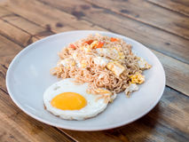 Delicious noodle with sunny up fried egg Royalty Free Stock Photography