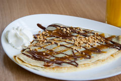 Delicious  nougat, caramel and peanuts pancake decorated with whi Stock Image