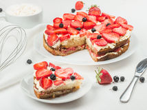 Delicious nutritious cake with fresh strawberries decorated with Royalty Free Stock Image