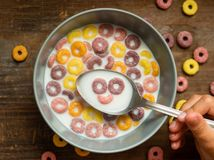Delicious and nutritious fruit cereal loops flavorful. Healthy and funny addition to kids breakfast stock images