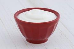 Plain greek yogurt. Delicious, nutritious and healthy fresh plain greek  yogurt on antique wood table Royalty Free Stock Photo