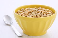Whole wheat cereal loops. Delicious and nutritious lightly toasted breakfast honey nuts cereal loops on vintage styling Stock Image